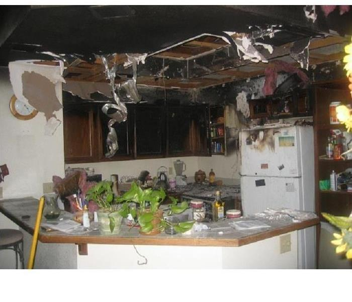 Severe Fire Damage in Kitchen