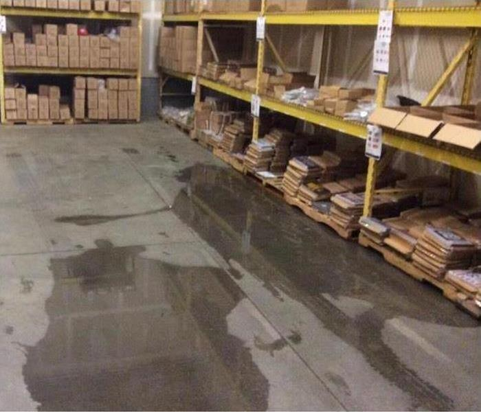 Water on the floor of a warehouse